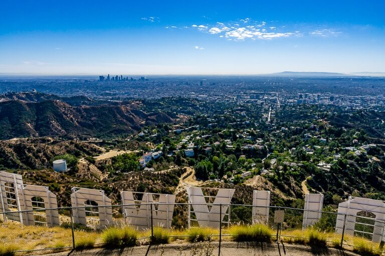 Hiking to the hollywood sign on mt lee with views over LA city is one of the best things to do in Los Angeles California