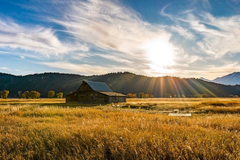 Best time to visit grand teton national park spring and fall when weather is perfect and fewer crowds sunburst over ta moulton barn