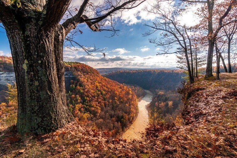 Best time to visit new york is fall for colorful foliage river running through gorge