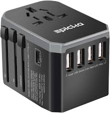 Travel adapter with plug options for all countries and 4 x usb slots for charging electronics