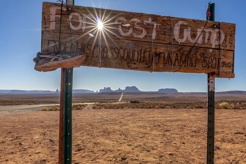 Forrest gump sign at monument valley with starburst on the sun