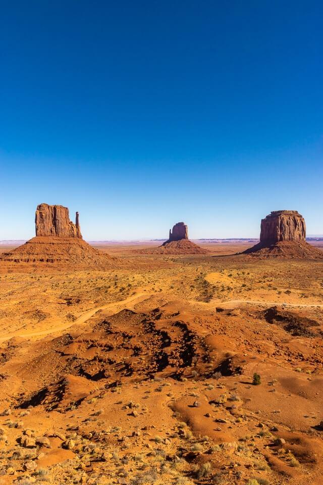 Three buttes at monument valley arizona hot arid desert