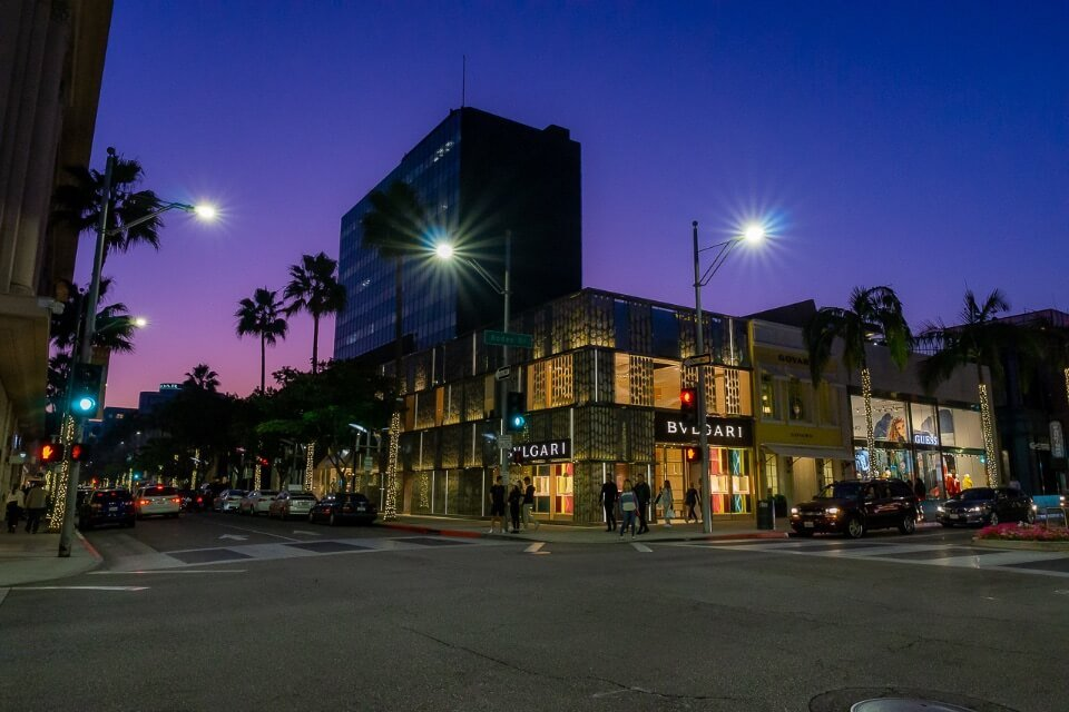 Beverly Hills Los Angeles California at night purple sky behind high end shopping