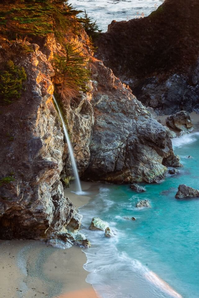 McWay Falls is one of the best stops along the california pacific coast highway stunning images of the waterfall hitting the sandy beach and turquoise water