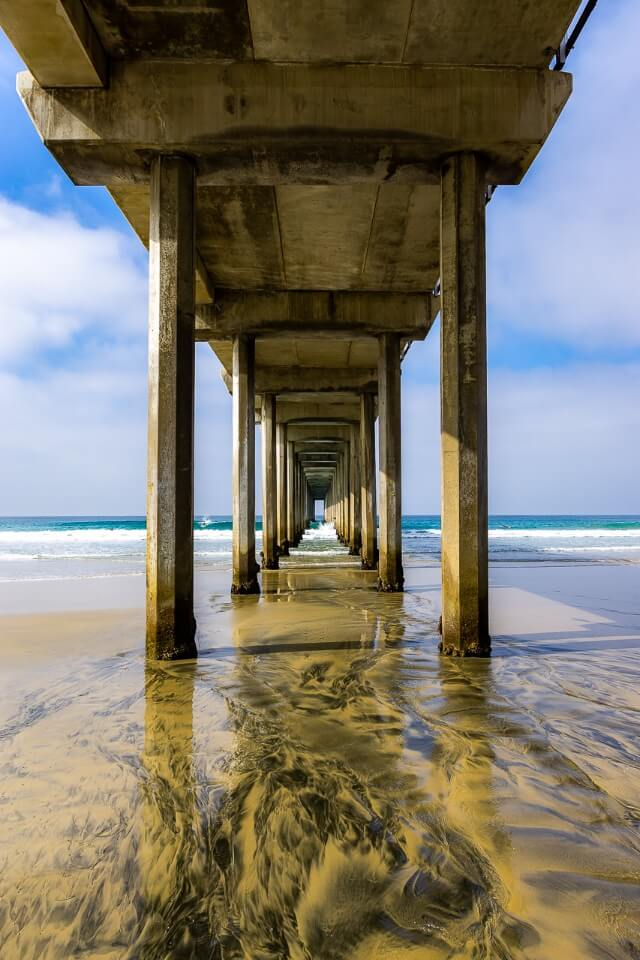 Scripps Oceanography Ellen Browning Pier on a beach in San Diego California columns look like a tunnel awesome travel photography