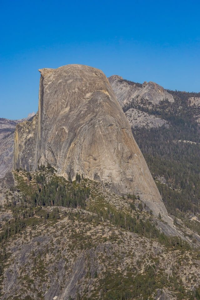 Half Dome at Yosemite national park california - view from the side shows the severity of its steep edges and grandeur