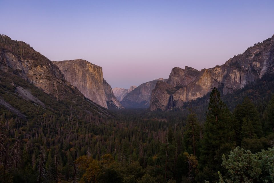 Yosemite national park valley from tunnel view is one of the most famous landscape pictures of america stunning purples at dusk