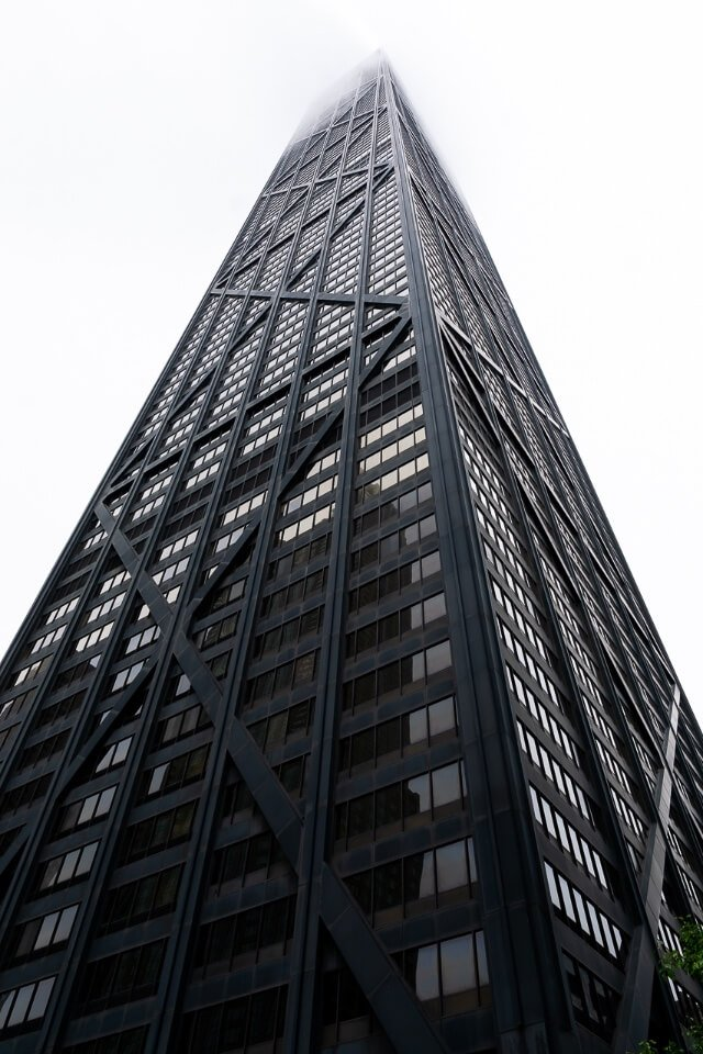 Sears Willis tower disappearing into dense clouds in chicago illinois
