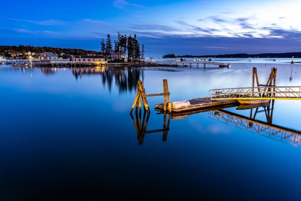 Sunset at boothbay harbor in maine usa still water with reflections of island and jetty