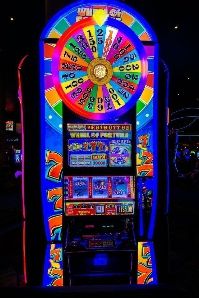 Wheel of fortune slot machine in las vegas lit up multi colors in a casino