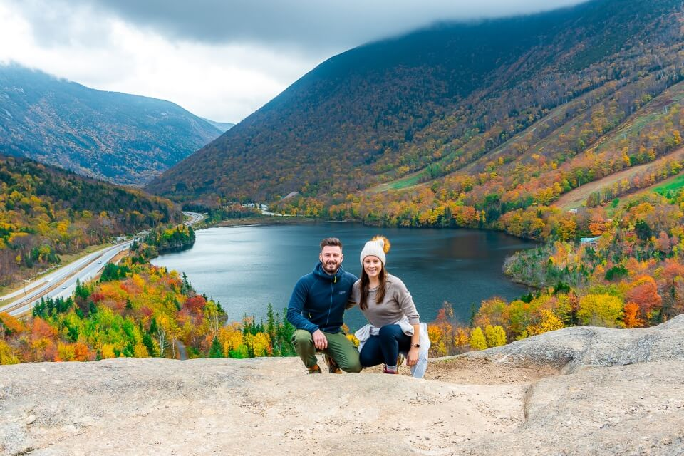 Mark and Kristen where are those morgans travel blog crouched down on artists bluff franconia notch state park new hampshire in fall with stunning colors and dark clouds pictures of america