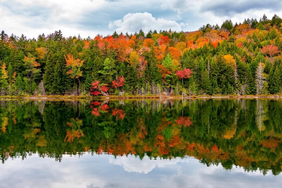 Heart lake reflecting fall foliage trees along kancamagus highway new hampshire