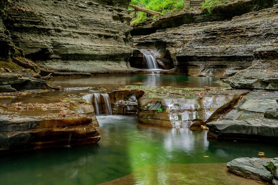 Buttermilk Falls state park in new york finger lakes small waterfalls with flat smooth rocks