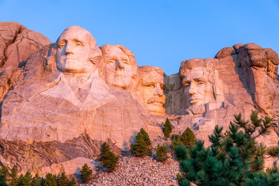Mount Rushmore illuminate pink as the first rays of sunlight hit the granite structure famous pictures of america
