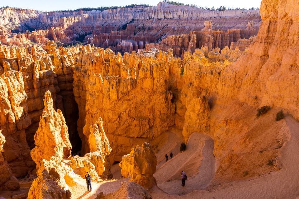 Switchbacks on sandy hiking trails into jagged orange rocks bryce canyon national park utah