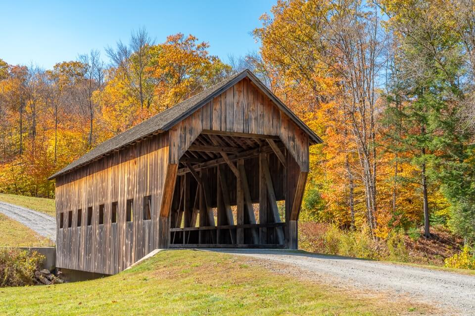 Perfect and picturesque wooden covered bridge in fall foliage gorgeous picture in northeast america