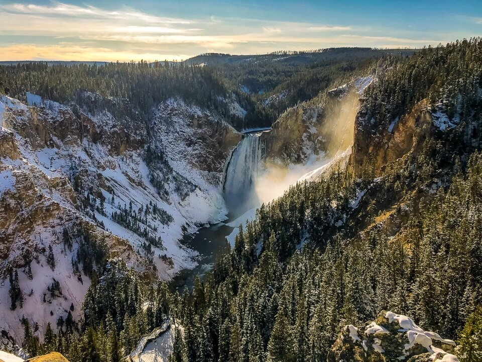 Yellowstone falls waterfall and grand canyon of the yellowstone in snow and ice cold but sunny weather famous pictures of america