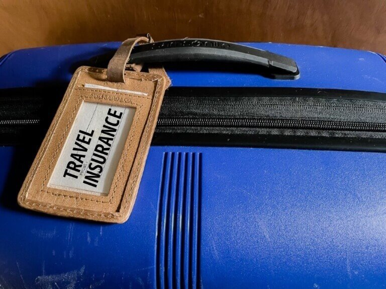Suitcase and Tag with Travel Insurance always travel with protection in case of emergency