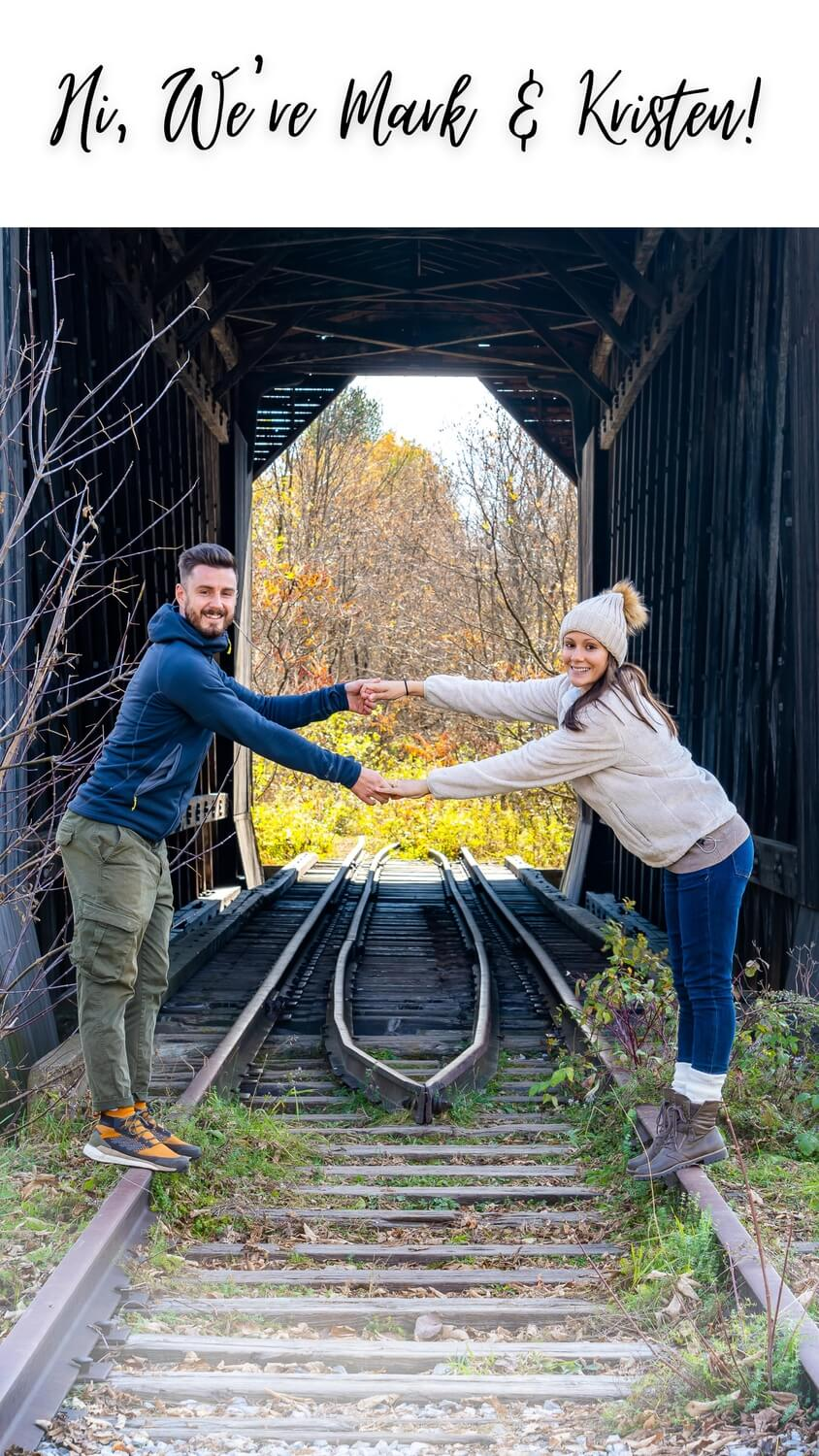 wherearethosemorgans travel adventure photography blog about page mark and kristen on a railroad track in New Hampshire in fall