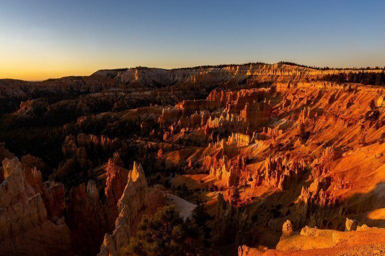 Yellow sun creating a staggering red burning effect on the sandstone rocks in Utah