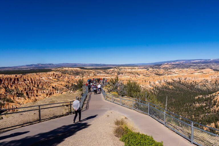 Scenic overlook walkway with barrier overlooking valley in utah