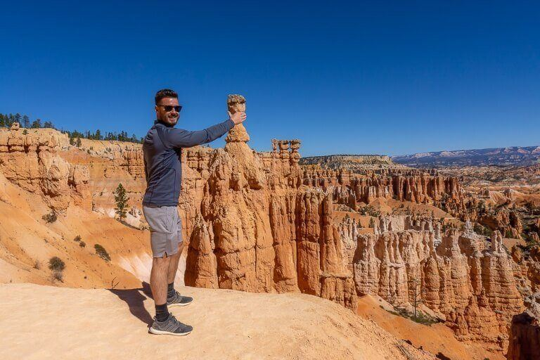 Mark grabbing Thor's hammer to see if he is worthy in bryce canyon national park utah