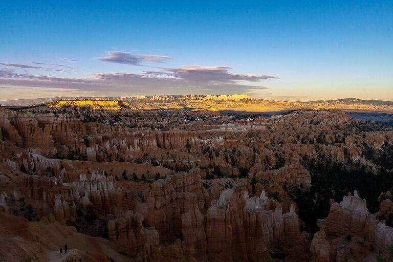 Sunset at bryce canyon photography interesting as shadows on hoodoos below with yellow sun lighting up distant hills