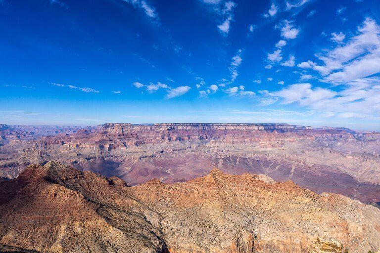 Grand Canyon National Park Sunrise and Sunset Photography Best Locations Tips Beautiful Views into colorful canyon with blue sky