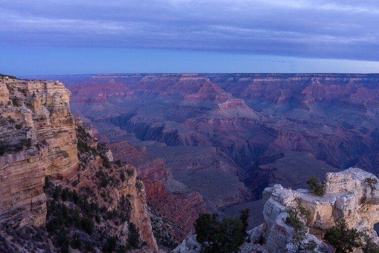 Mather Point from along the Rim with purple canyon rocks and clouds