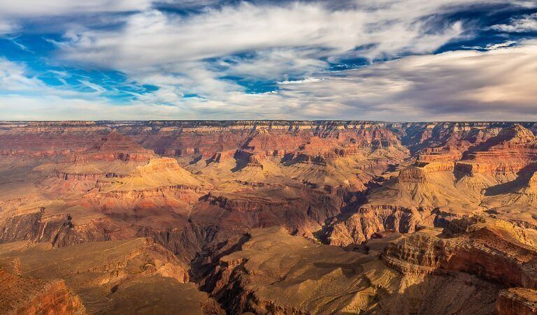 Yavapai Point in late afternoon before sunset at the grand canyon south rim with stunning contrast against the sky and clouds