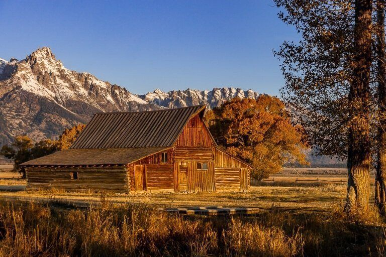 Barn in the sun with shadows and mountains