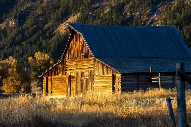 TA Moulton barn front illuminated yellow at sunrise