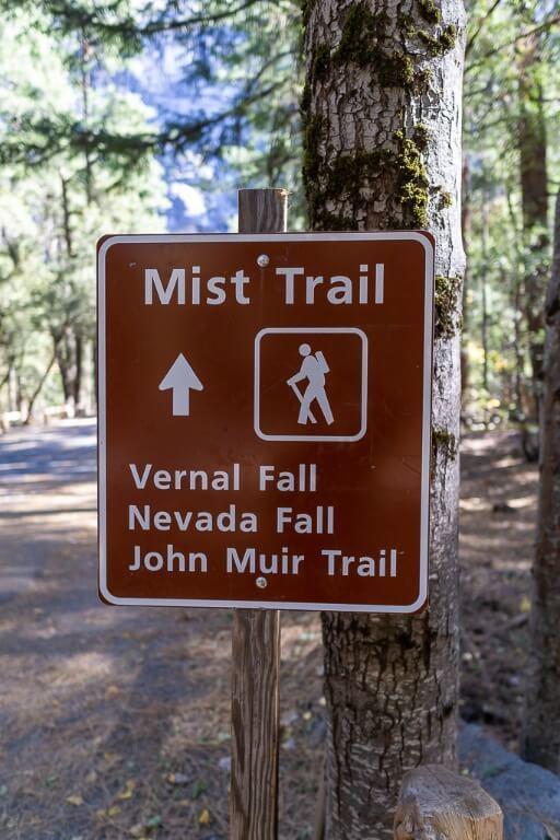 Yosemite Mist Trail sign showing vernal fall nevada fall and john muir trail hike