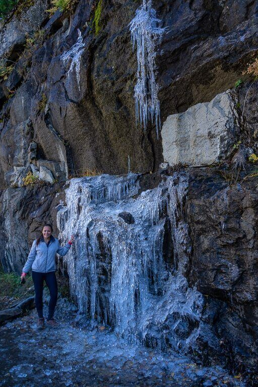 Kristen stood next to icicles formed on the John Muir trail in October frozen water