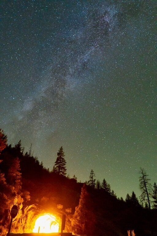 Tunnel view yosemite national park astrophotography star photograph with orange glow from tunnel milky way