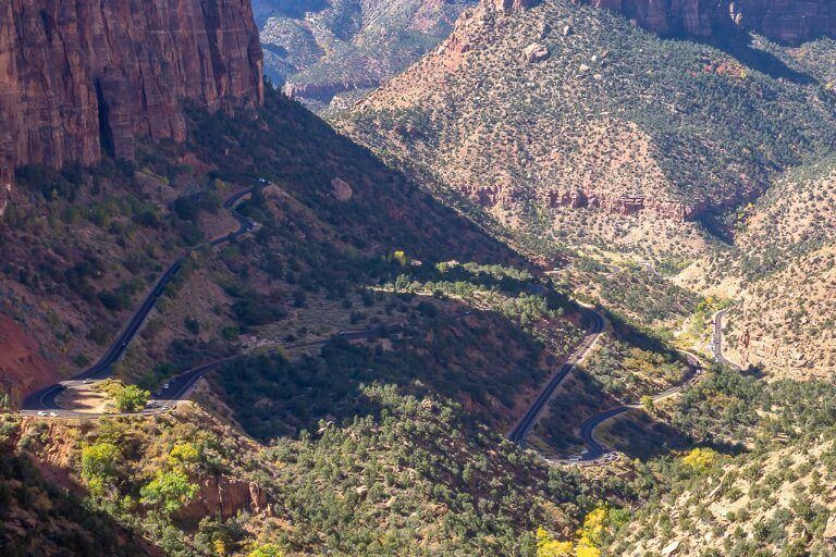 Zion canyon overlook trail hike summit telephoto lens or binocular zoom in on zion switchback roads near zion-mount carmel tunnel
