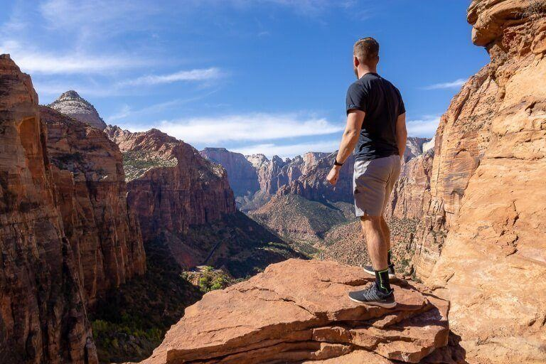Mark stood on the edge of a cliff with an impressive view in utah