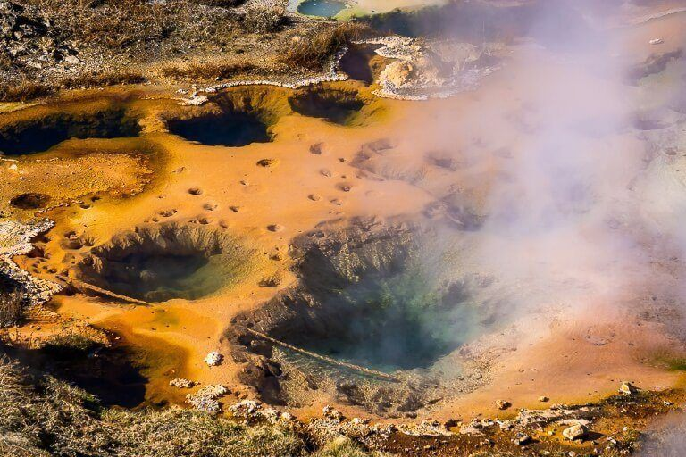 Bubbling colorful steaming mud pots in wyoming