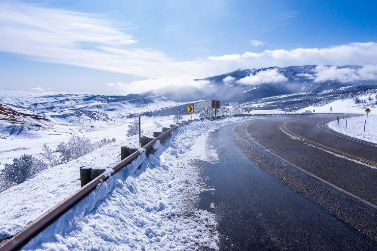 Snow and white northeast entrance to Yellowstone National Park perfect for flying into Cody or Bozeman or Denver