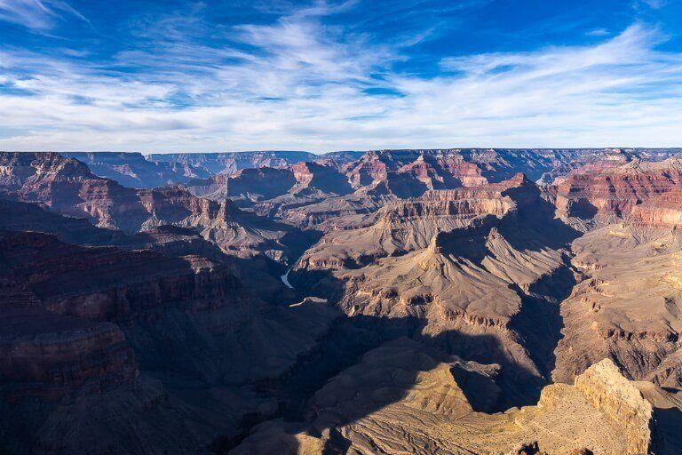Pima Point view into the grand canyon before sunset late afternoon shadows beginning to cast across the canyon