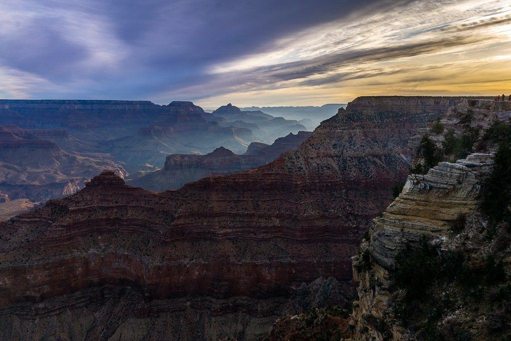 Epic grand canyon sunrise sunset photography guide sun rising at Yavapai Point stunning colors in the sky and canyon lighting up