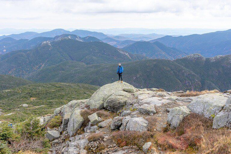 Awesome views at the summit of Mount Marcy hiking trail in adirondacks ny with rolling peak tops as far as the eye can see