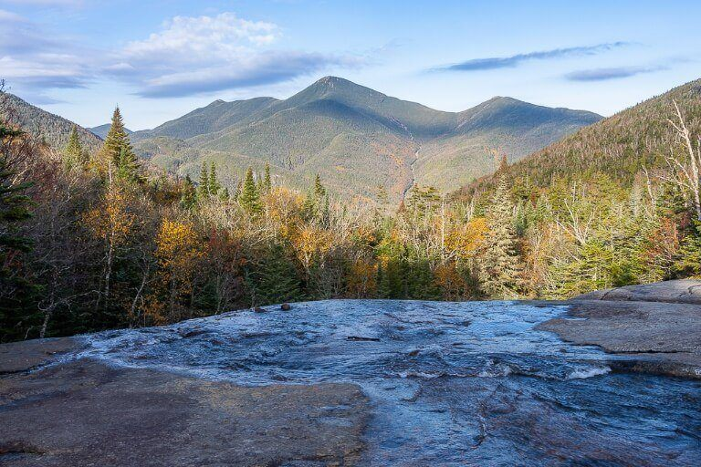 Indian Falls waterfall on the Mount Marcy hiking trail in lake placid adirondacks new york with stunning views of rolling hills