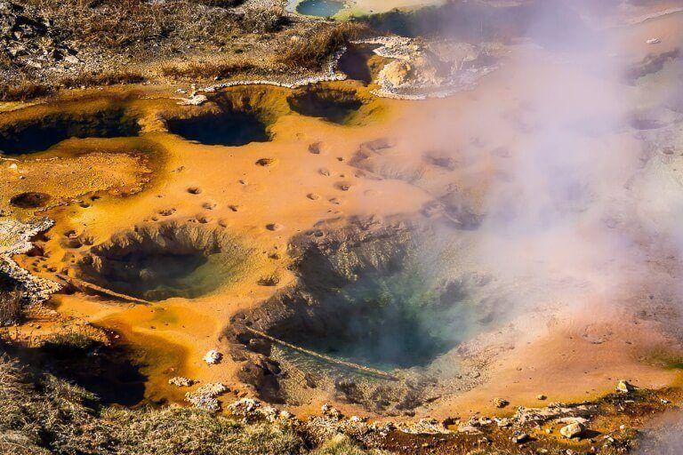 Hot Springs orange vibrant color artist paint pot near norris geyser basin