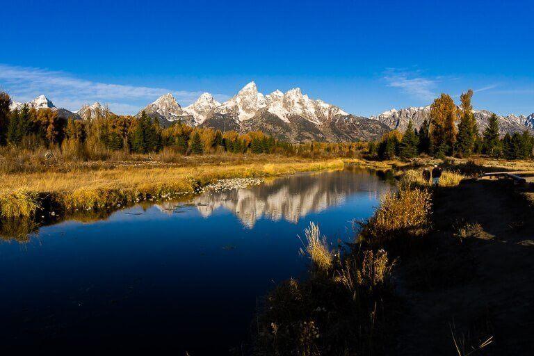 Mountain range reflecting on still water in wyoming