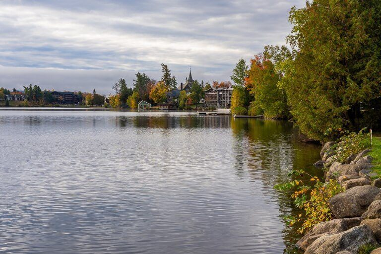 Banks of Mirror Lake with hotels and colorful trees in Fall