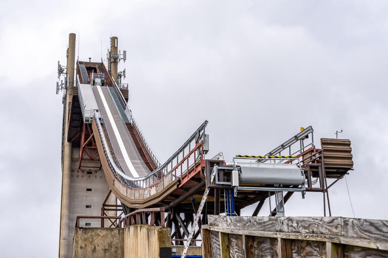 Olympic Ski Jump in Lake Placid NY from below and to the side showing the jumping point and steepness of drop