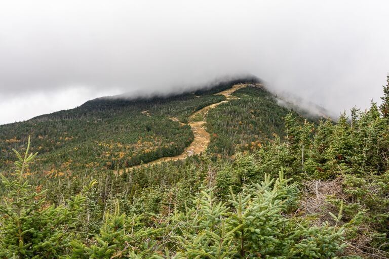 Whiteface Mountain summit covered in dense grey clouds