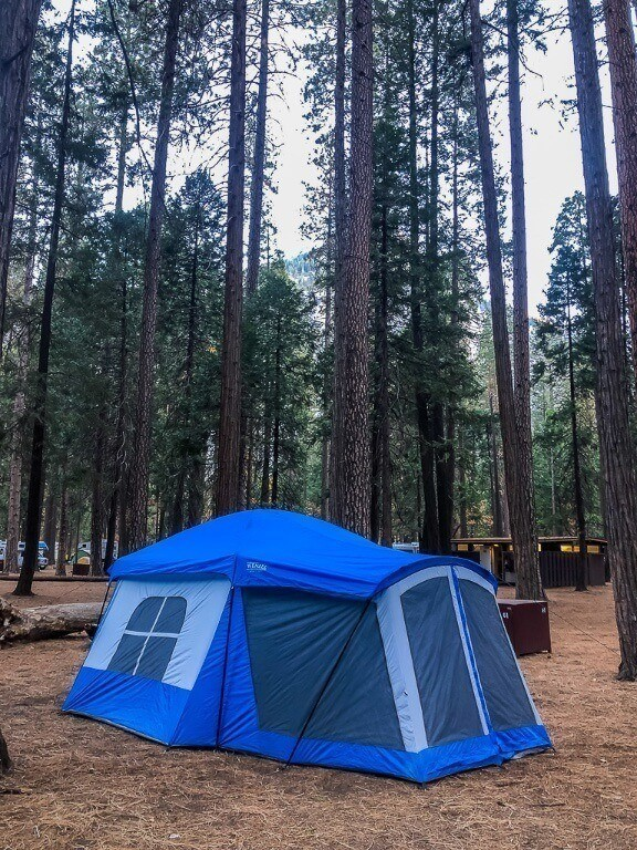 Blue tent in forest at upper pines campground where to stay in yosemite national park