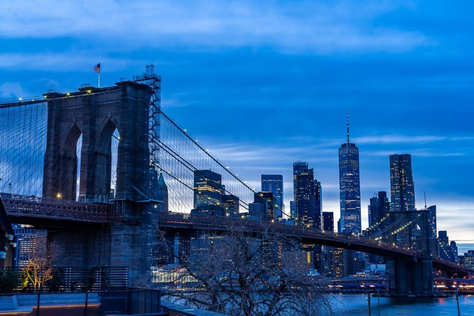 Brooklyn Bridge photography at night from Time Out Market roof terrace in Brooklyn blue clouds at sunset and dusk before darkness